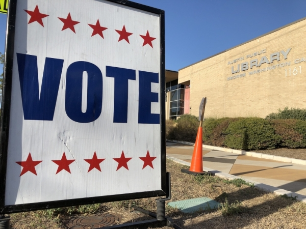 A sign directs voters at the Austin Public Library George Washington Carver Branch during the November 2019 election. Early voting begins Feb. 18 in the 2020 primary election. Jack Flagler/Community Impact Newspaper