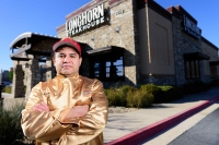 Cedar Park resident Jose Luis Sanchez—wearing the gold coat he received for grilling his millionth steak—is pictured outside LongHorn Steakhouse in Cedar Park. (Courtesy LongHorn Steakhouse)