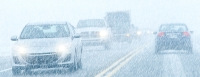 cars driving in wet snowy weather