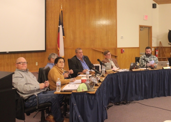 A photo of Dripping Springs City Council sitting in their chambers.