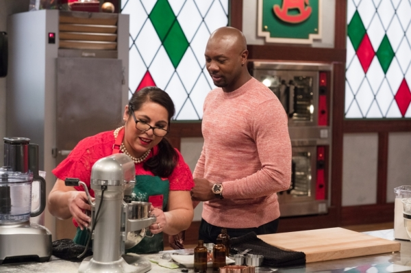 "Velma Perez competes on the Food Network's ""Christmas Cookie Challenge"" featuring host Eddie Jackson. (Courtesy Food Network)"