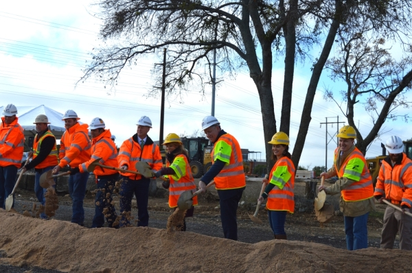 Officials from the Texas Department of Transportation and the city of Austin break ground on the RM 620 at RM 2222 bypass project. Iain Oldman/Community Impact Newspaper