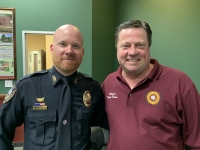 Mayor Todd Kana (right) and Magnolia City Council members appointed Lt. Kyle Montgomery (left) as the new police chief for the Magnolia Police Department at the Dec. 10 council meeting. (Kara McIntyre/Community Impact Newspaper)