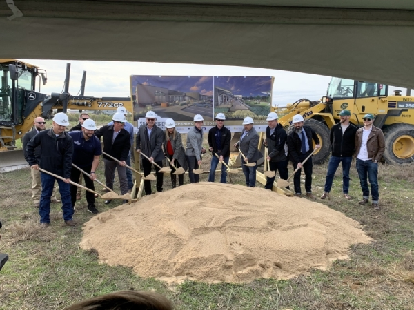 Members of the team working on Spare Birdie and local officials participated in the groundbreaking ceremony Dec. 14. (Marisa Charpentier/Community Impact Newspaper)