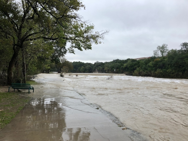 Blue Hole Park is pictured during the October 2018 floods. (Sally Grace Holtgrieve/Community Impact Newspaper).