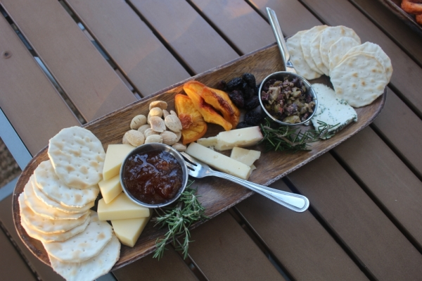 Patio Dolcetto serves a gourmet cheese board with three cheeses, dried fruit, nuts, olives, sour cherry jam and crackers. (Evelin Garcia/Community Impact Newspaper)