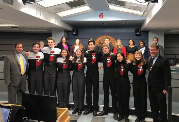 Members of the Bowie High School marching band were honored by Austin ISD trustees Dec. 16. (Nicholas Cicale/Community Impact Newspaper)