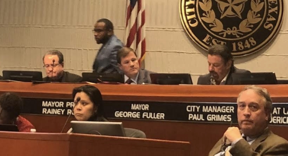 McKinney City Council Member La'Shadion Shemwell walked out during council comments shortly after council voted in favor of further investigations into a ethics complaint filed against Shemwell. (Emily Davis/Community Impact Newspaper)