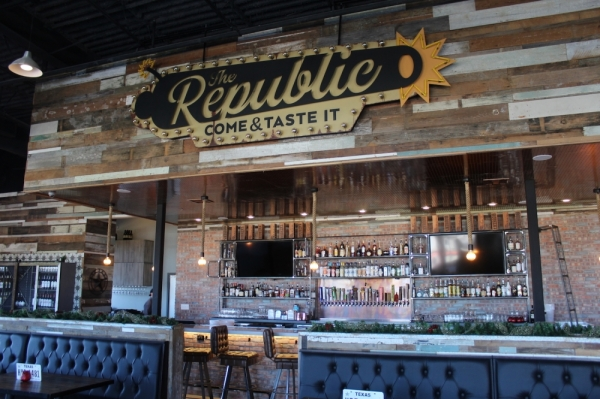 The Republic Kitchen + Bar has a bar and outdoor patio. (Marisa Charpentier/Community Impact Newspaper)