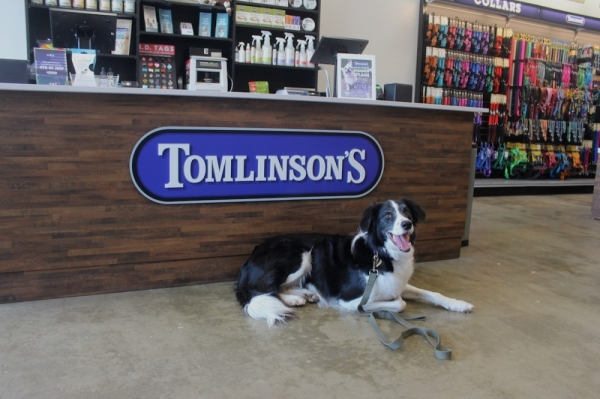 Through December 24, when customers purchase a bag of food for donation at any Tomlinson's Feed store, Tomlinson's will match the donation pound for pound with high-quality pet food. (Courtesy Tomlinson's Feed)