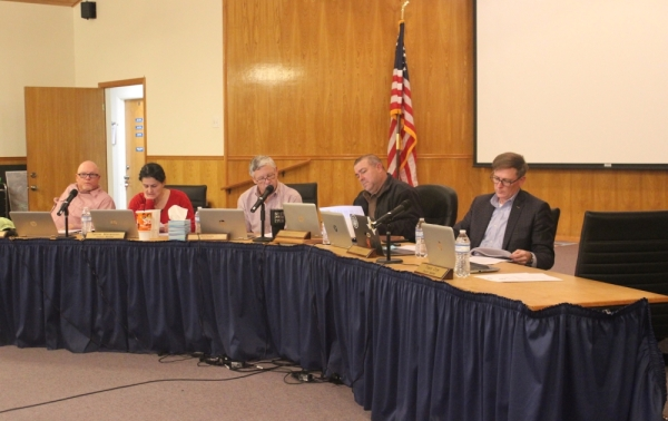 A photo of the Dripping Springs City Council considering an agenda item.