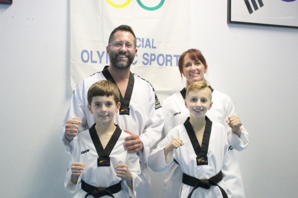 Pro Taekwondo is a family business owned by Daryl and Mandi Rhyne. Their sons Ryder and Kage also practice taekwondo, which teaches skills, such as confidence and discipline.  Renee Yan/Community Impact Newspaper