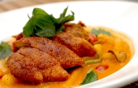 The roasted duck curry ($29.99) at Napa Thai and Asian Cuisine is one of the restaurant's most popular dishes, featuring a creamy sauce made with red chilis and served with rice. (Renee Yan/Community impact Newspaper)