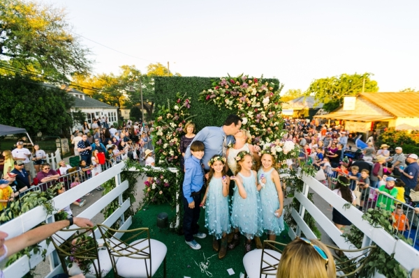 "For Dripping Springs' Founders Day in 2019, Whim Hospitality sponsored a float with a live wedding to honor the ""Wedding Capital of Texas."" Courtesy Al Gawlick Photography"
