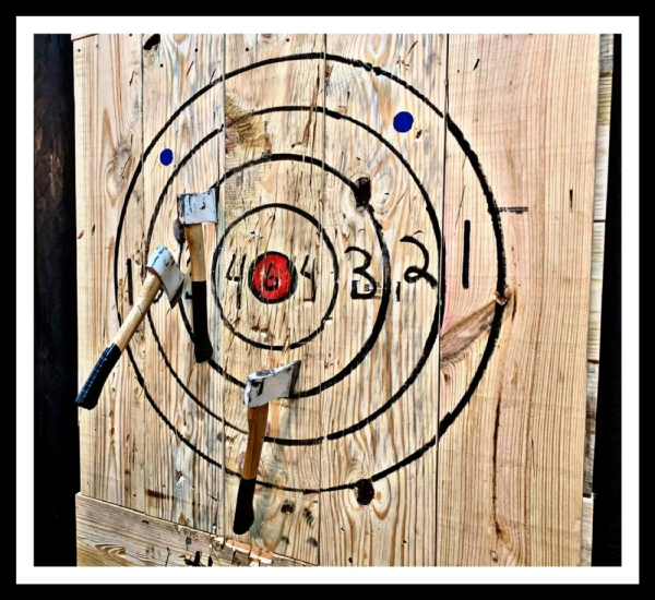 axes stuck in a throwing target