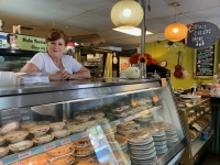 Texas Pie Company's Julie Albertson stands behind the counter at the shop. (Community Impact Newspaper)