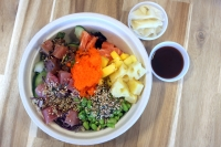 Poke Bowl offers two sizes of bowls with either three scoops of protein or four. Customers can choose from unlimited toppings.