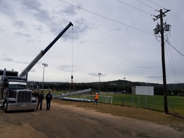 Workers from Musco Sports Lighting unload lighting equipment at Bee Cave's Field of Dreams sports complex Jan. 2. (Courtesy Brian Chesney)