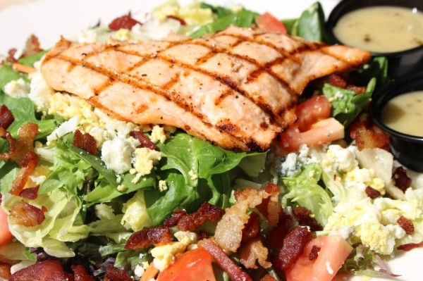 The cobb salad ($8.50) contains diced avocado, tomatoes, blue cheese crumbles, eggs and a house remoulade. Customers can also add their choice of protein: chicken, shrimp, ahi tuna or salmon ($3-$6). (Renee Yan/Community Impact Newspaper)