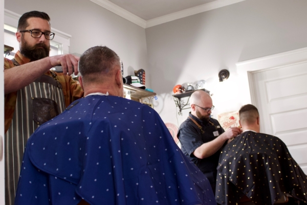 From left: Will Santoliquido and Dennis Burky cut hair at Round Rock Barber Shop. (Taylor Jackson Buchanan/Community Impact Newspaper)