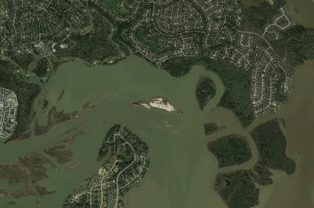 Contractors mobilized the week of Jan. 6 to remove sediment from the mouth bar. (Courtesy Google Earth)