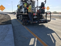 Workers are finishing striping the pavement for the new southbound SH 130 to westbound Toll 290 flyover that opens the weekend of Jan. 11. (Courtesy Central Texas Regional Mobility Authority)