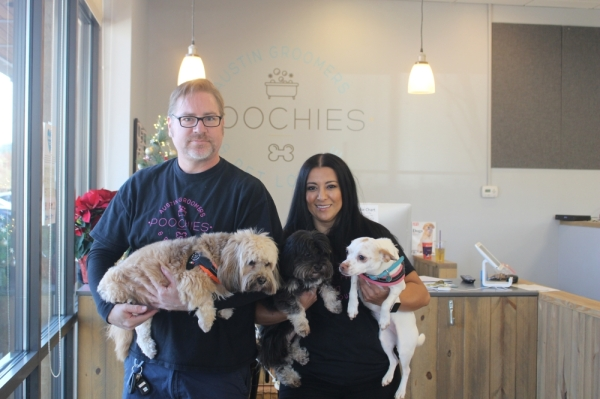 Peter and Mariana Meredith were inspired by their dogs, Frida, Chato and Oso, to open Poochie's Austin Groomers & Pet Lounge.  Amy Rae Dadamo/Community Impact Newspaper