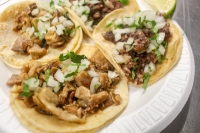Tacos El Primo serves tacos with a variety of meats, including asada, pastor, cabeza, lengua, buche and carnitas. (Evelin Garcia/Community Impact Newspaper)