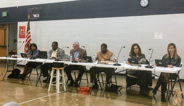 Franklin Special School District board meeting in gymnasium