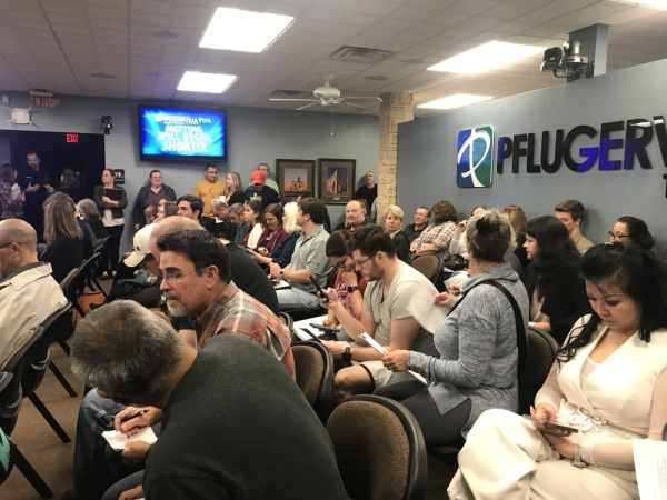 "Pflugerville City Hall was standing room only at Pflugerville City Council's Jan. 14 meeting for the first ordinance reading on ""Project Charm,"" a 3.8 million-square-foot distribution center. (Kelsey Thompson/Community Impact Newspaper)"
