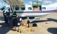 mission regan loading supply plane mckinney
