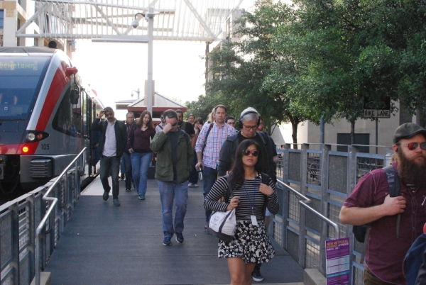 Commuters arrive at downtown Austin's lone light rail stop. (Christopher Neely/Community Impact Newspaper)