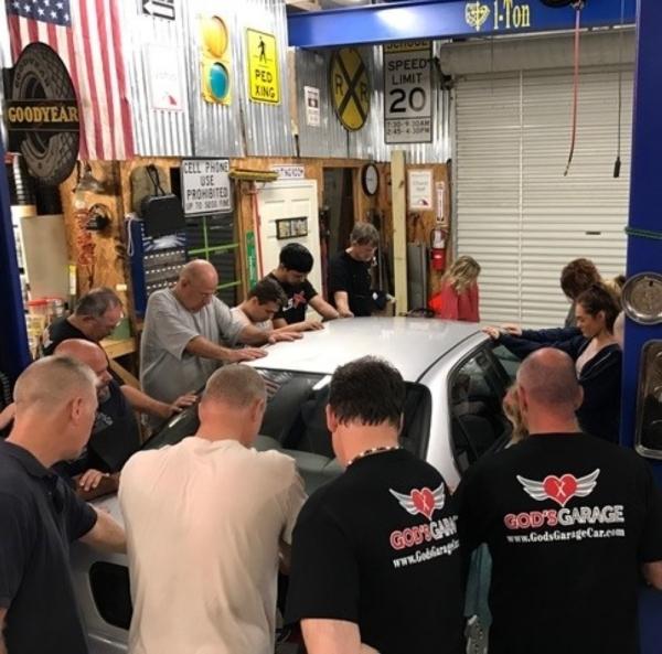 God's Garage team in prayer