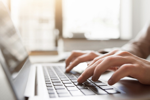 hands typing on a laptop keyboard fotolia stock image