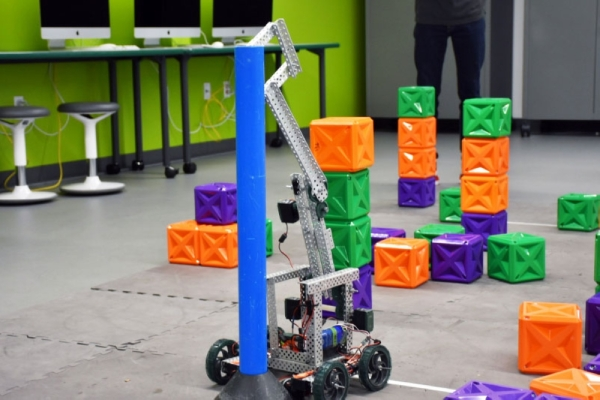 This robot operated by a student navigates objects in The STEM Center. (Makenzie Plusnick/Community Impact Newspaper)