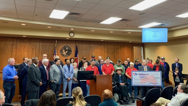 Texas Disposal Systems presented a symbolic check for $1.5 million to the city of Kyle. (Community Impact Newspaper staff)