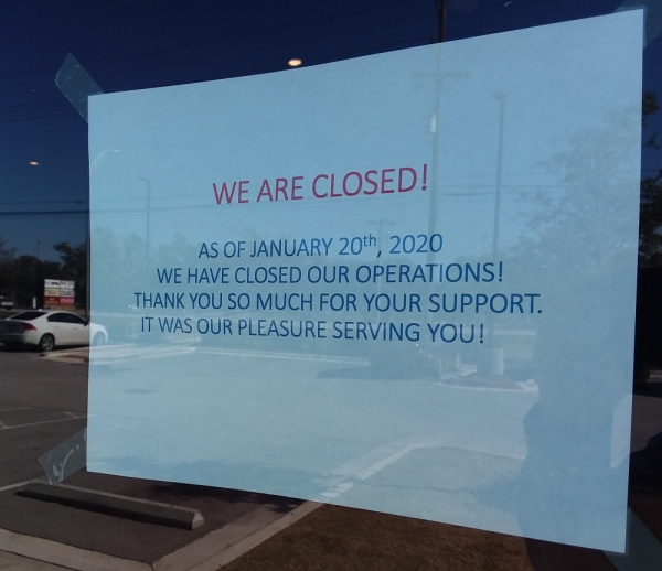 This sign was on the front door of Russo's on Jan. 23. (Brian Perdue/Community Impact Newspaper)