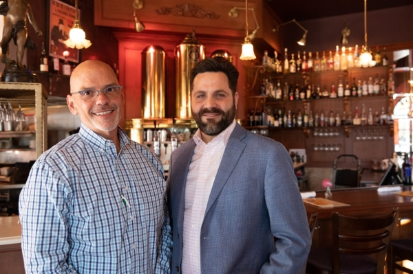 Craig Knapp (left) manages the Plano location on a daily basis. CEO William Pitts visits each of Cafe Intermezzo's six locations at least once a month. (Liesbeth Powers/Community Impact Newspaper)