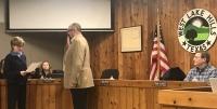 Mayor Linda Anthony swears in the new city administrator Travis Askey. (Amy Rae Dadamo/Community Impact Newspaper)