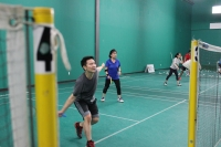 A student gets into position to hit the birdie in a class at Plano Badminton Center. (Daniel Houston/Community Impact Newspaper)