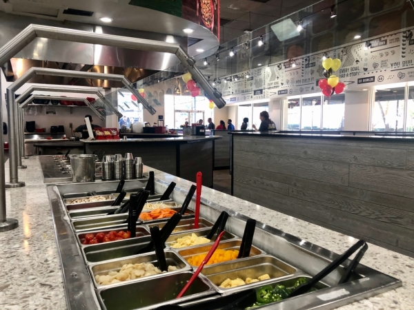 The restaurant opened with updated decor and a new takeout area in January. (Courtesy Genghis Grill)