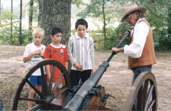 Children watch a pioneer demonstration at the Heritage Museum. (Courtesy Heritage Museum of Montgomery County)