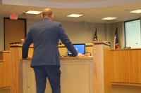 Darren Hess, the director of Montgomery County's Office of Homeland Security and Emergency Management, addresses commissioners Jan. 27. (Eva Vigh/Community Impact Newspaper)