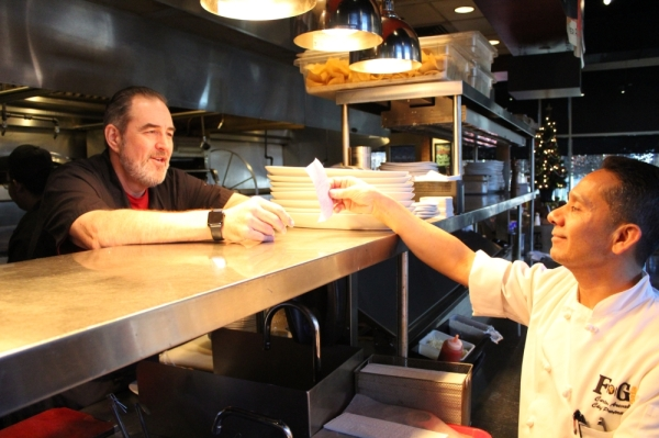 Chefs Bob Stephenson (left) and Carlos Arevalo (right) have been working together for about 21 years. They opened FnG Eats together in Keller in 2012. (Renee Yan/Community Impact Newspaper)