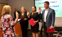 From left: Eanes ISD trustees Ellen Balthazar, Heather Sheffield and James Spradley take the oath of office following the May 2019 election. (Sally Grace Holtgrieve/Community Impact Newspaper)