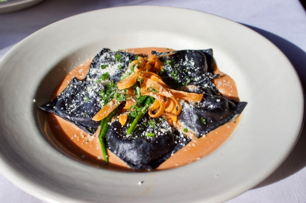 Black linguine stuffed ravioli is served with a house-made pink sauce. (Taylor Jackson Buchanan/Community Impact Newspaper)
