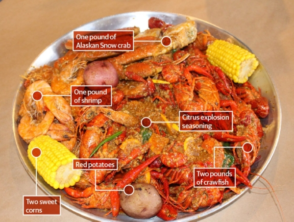 The Fisherman's Catch special ($49.99) •includes two pounds of crawfish, one pound of Alaskan Snow crab, one pound of shrimp, two sweet corns and two red potatoes. The platter above was flavored with Crab Heads Cajun Boil's citrus explosion seasoning. Serves 2-3 people. (Claire Shoop/Community Impact Newspaper)