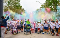 Community members of all ages can get covered in colored powder and raise money for Lake Houston Family YMCA programs at the annual Bridge Fest Color Run. (Courtesy Lake Houston Family YMCA)