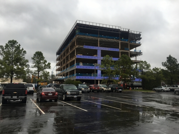 An office building is under construction at Lakeside Boulevard and Technology Forest Boulevard. (Vanessa Holt/Community Impact Newspaper)