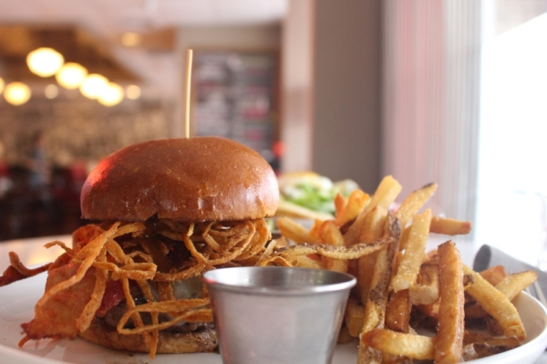 The Society Burger is ground in-house and priced at $11.99. (Amy Rae Dadamo/Community Impact Newspaper)